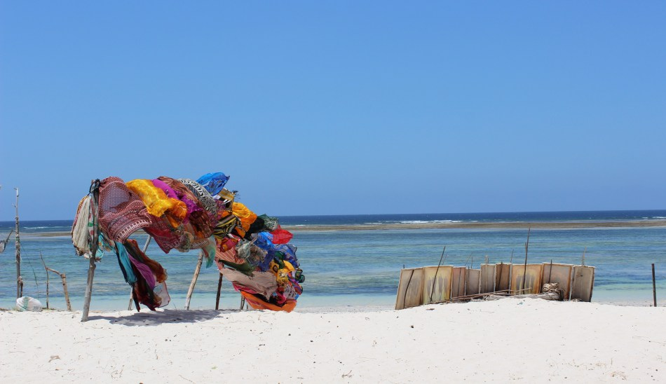 Scarves and paintings on sale, Diani Beach, Kenya